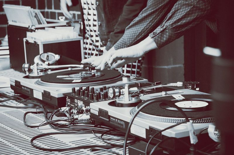 Two People Using Dj Turntables