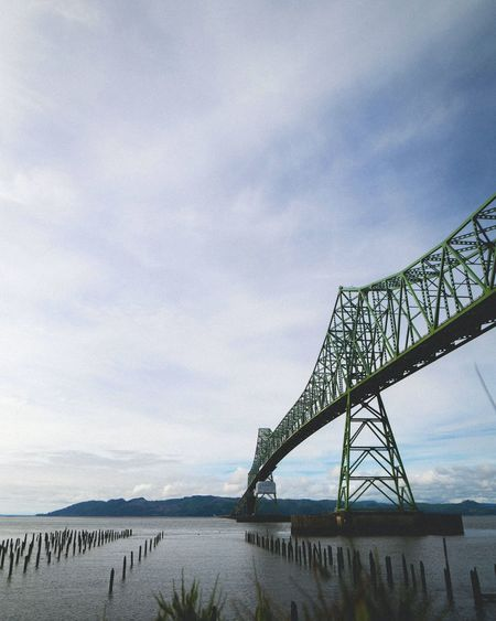 Low angle view of astoriamegler bridge over columbia river against sky