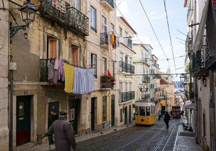 street in old Lisbon, Portugal Architecture Building Exterior Laudrytime Lisbon Old Town Portugal Tram Transportation Yellow
