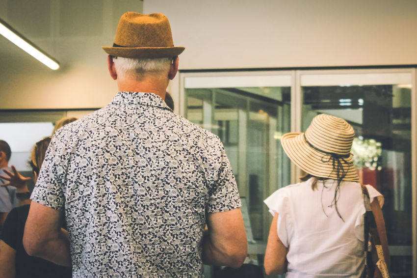 Cap Casual Clothing Couple - Relationship Day Hat Heterosexual Couple Leisure Activity Lifestyles Married Couple Men Real People Rear View Standing Togetherness Two People Women