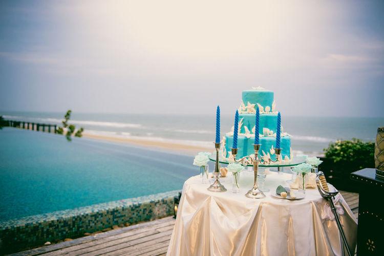 Blue wedding cake on wedding ceremony at seaside