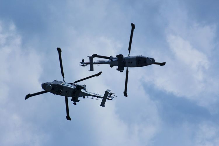 Military Helicopter Back To Back During Operation