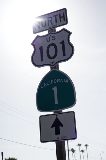 101 California No. 1 Clock Face Day Minute Hand No People North Outdoors Palm Palm Tree Palm Trees Reflection Road Sign Sun Sunset