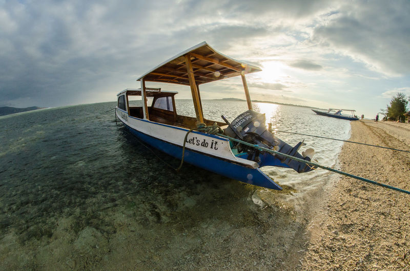 Beauty In Nature Boat Calm Cloud Cloud - Sky Cloudy Day Horizon Over Water Idyllic Mode Of Transport Nature Nautical Vessel No People Non-urban Scene Ocean Outdoors Overcast Remote Scenics Sea Shore Sky Tranquil Scene Tranquility Water