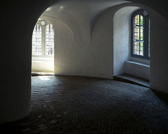 København Roundtower Absence Arcade Arch Arched Architectural Column Architecture Building Built Structure Corridor Day Empty Flooring History Indoors  Nature No People Religion Rundetaarn Sunlight The Past Wall Window