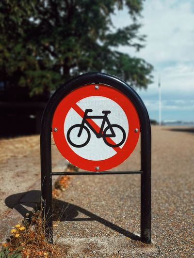 Close-up of bicycle lane sign on road