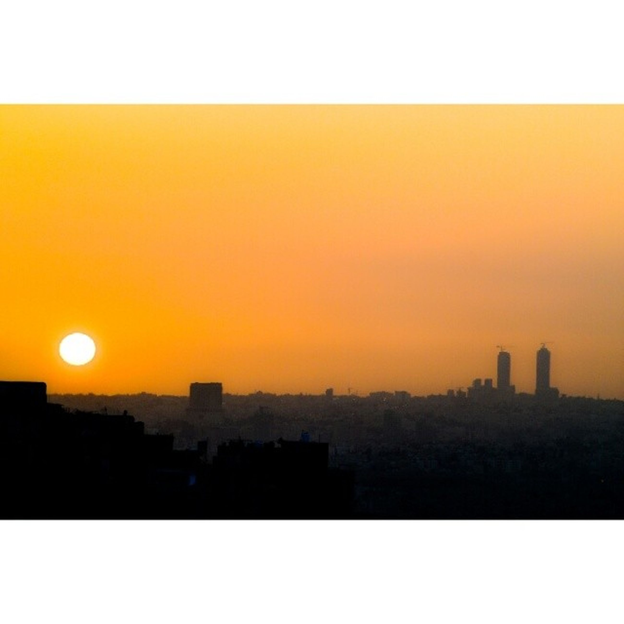 sunset, transfer print, orange color, building exterior, sun, architecture, auto post production filter, copy space, built structure, silhouette, clear sky, city, cityscape, scenics, sunlight, sky, beauty in nature, nature, outdoors, no people