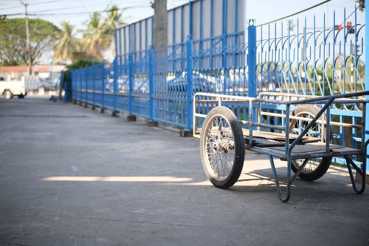 Bicycle parked by railing in city