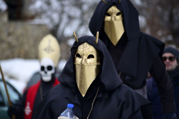 People wearing mask during event in city