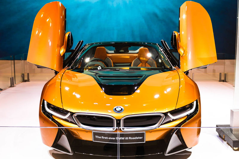 BMW i8 Roadster at GIIAS 2018 I8 Roadster Absence Bmw Car Close-up Day Headlight Indoors  Land Vehicle Metal Mode Of Transportation Motor Vehicle No People Orange Color Reflection Retro Styled Scooter Stationary Transportation Vehicle Hood Wheel Yellow