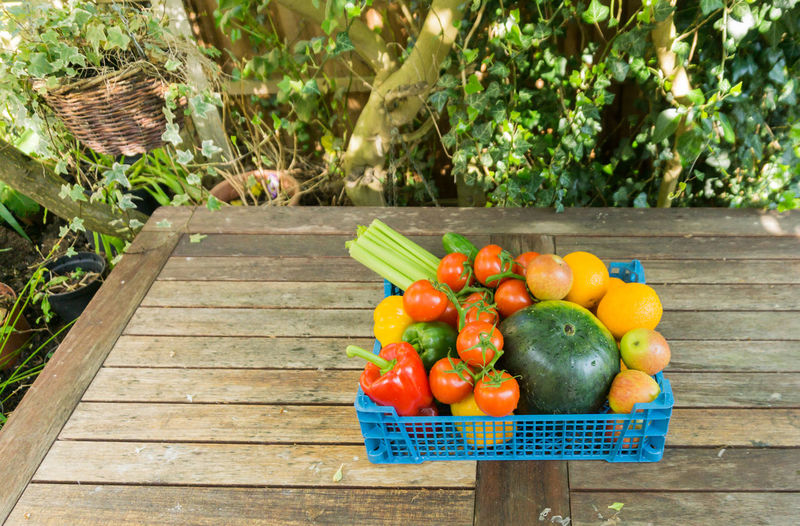 High angle view of colorful food in crate on table
