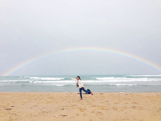 lucky rainbow Adults Only Beach Beauty In Nature Day Double Rainbow Full Length Horizon Over Water Leisure Activity Lifestyles Motion Multi Colored Nature One Man Only One Person Only Men Outdoors Rainbow Sand Scenics Sea Sky Standing Tranquility Water Wave
