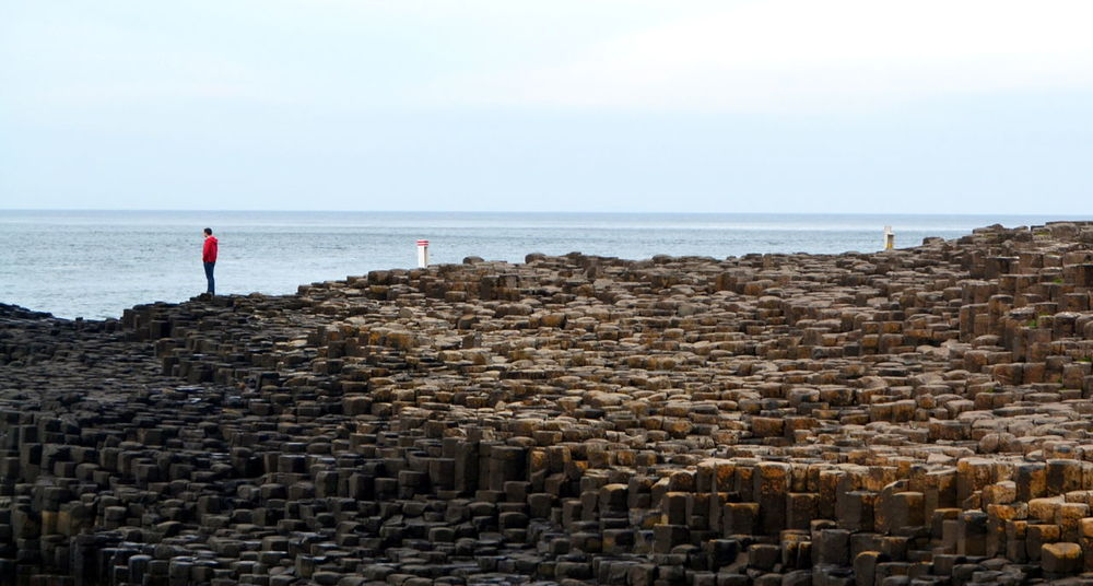 Beauty In Nature Giant Causeway Horizon Horizon Over Water Incidental People Man And Nature Man And Sea Nature Scenics - Nature Sea Sky Stone Wall Tranquil Scene Travel Destination Travel Destinations Water