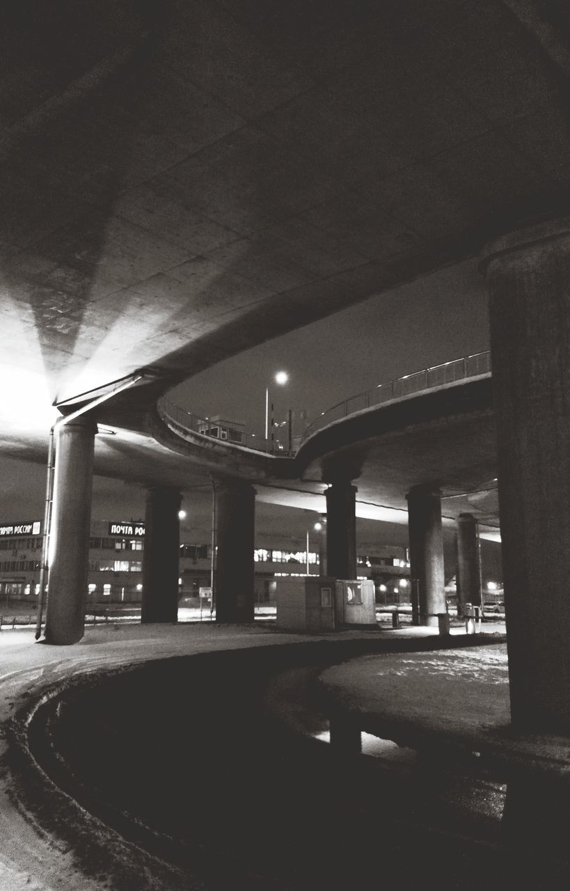 architecture, architectural column, built structure, illuminated, transportation, indoors, bridge - man made structure, no people, road, night, underneath, city, parking garage