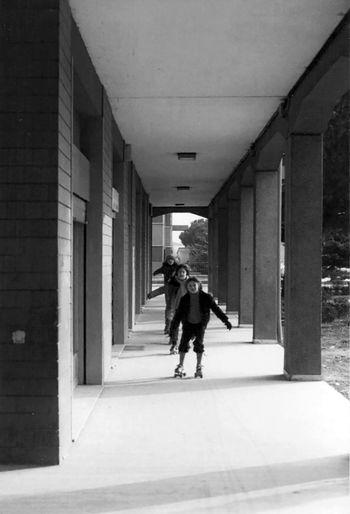Children roller skating in corridor