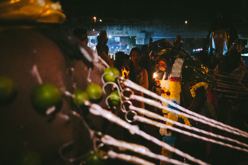 Arts Culture And Entertainment Celebration Close-up Cultures Detail Drop Focus On Foreground Glowing Hanging Holding Illuminated Lifestyles Men Music Night Occupation Real People Selective Focus Colors Of Carnival Thaipusam2016 The Photojournalist - 2016 EyeEm Awards