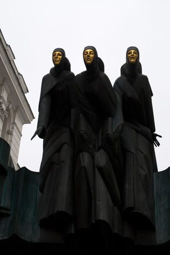 Three Muses on the top of Theatre of Vilnius Drama Gediminas Lithuania National Statue Vilnius Human Representation Lithuanian Low Angle View Muses Outdoors Sculpture Statue Theatre Three Travel Destinations