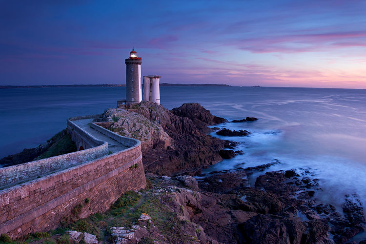 View of Lighthouse of Petit Minou in Brittany in France Bretagne Brittany Coastline France Lighthouse Nature Rock Rock Formation Architecture Coast Direction Guidance Landmark Landscape Lighthouse Marine Nautical Navigation Ocean Phare Safety Scenics Sea Sunset Water