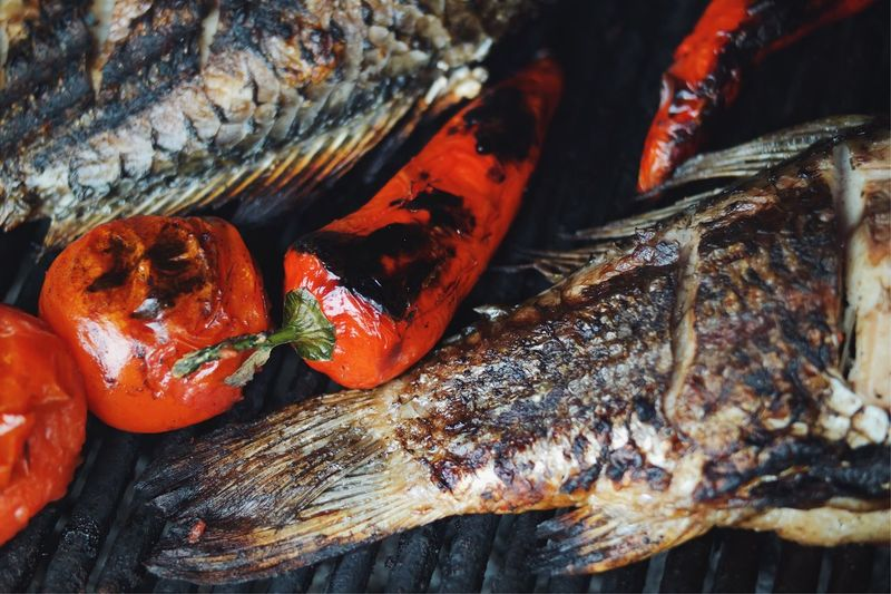 Close-up of seafood and vegetables on grill