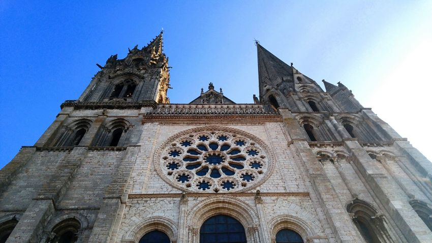 Blue Architecture Sky Travel Destinations Built Structure Building Exterior Clear Sky No People Rose Window Religion Low Angle View Archival Time Outdoors Cultures Day Gothic Style at Chartres , France