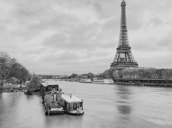 Paris flooded ShotOnIphone Paris Water Architecture Sky Nautical Vessel Travel Destinations Cloud - Sky Built Structure City Tourism Tower Outdoors No People