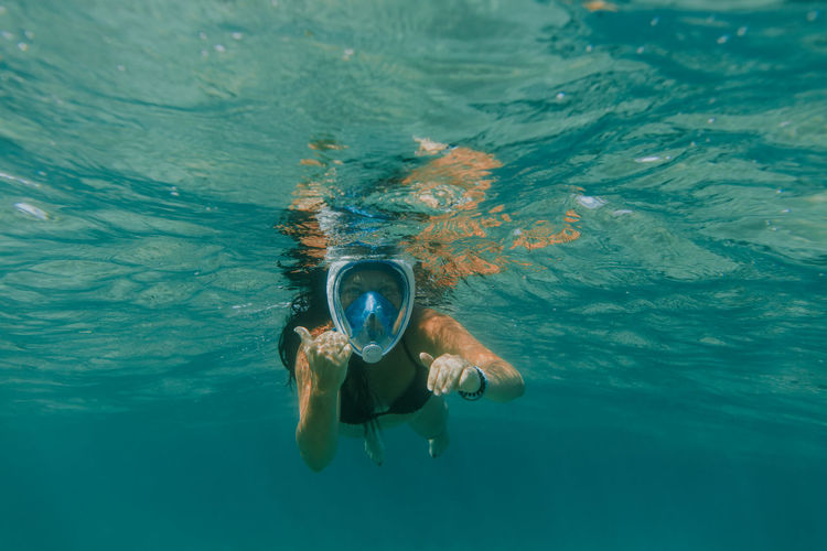Portrait of woman snorkeling undersea