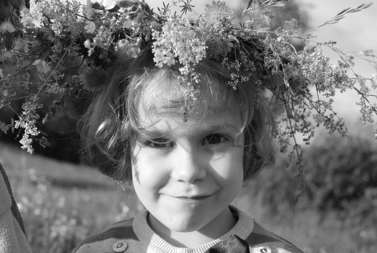 Close-Up Portrait Of Girl With Flower Crown
