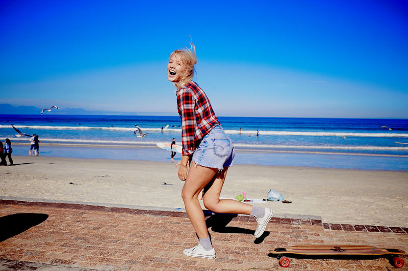 Adult Adults Only Beach Beautiful Woman Blond Hair Blue Day Full Length Happiness Horizon Over Water Looking At Camera Nature One Person Only Women Outdoors Real People Sand Sea Sky Smiling Standing Summer Vacations Women Young Adult