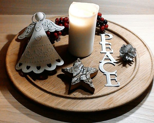Peace Christmas Decorations Christmas Angel Berries Lit Candle In Memory Pine Cone Wood Wooden Plate