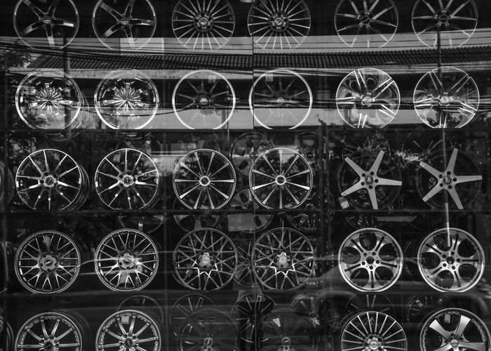 Architecture Arrangement Backgrounds Building Exterior Complexity Design Full Frame Geometric Shape In A Row Max Wheel Metal Mode Of Transportation Night No People Outdoors Pattern Power Supply Repetition Side By Side Transportation Wheel