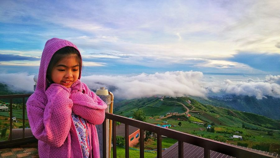 Girl Standing Outdoors Against Mountain