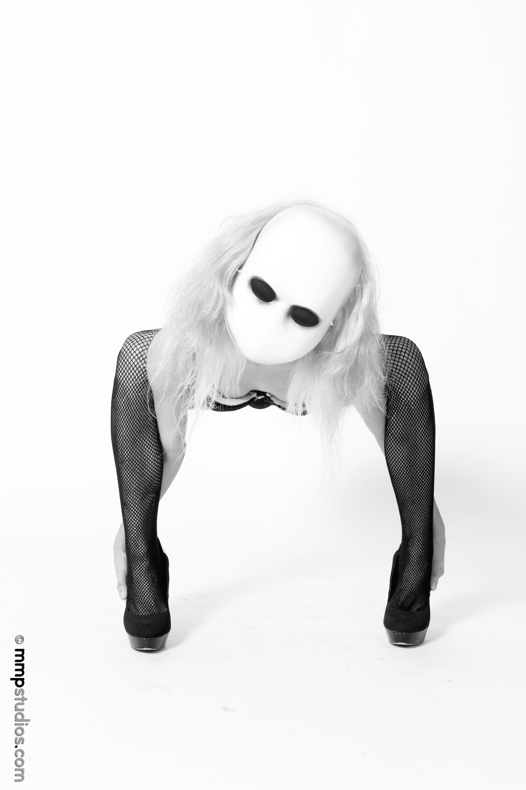 white background, studio shot, hair, indoors, young women, fashion, hairstyle, one person, long hair, disguise, young adult, mask, representation, women, mask - disguise, lifestyles, obscured face, beautiful woman