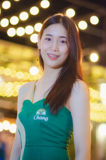 Asian Woman Asian Girl Asian Teen Beautiful Woman Beauty Focus On Foreground Front View Hair Hairstyle Happiness Illuminated Lifestyles Long Hair Looking At Camera One Person Portrait Real People Smiling Standing Women Young Adult Young Women