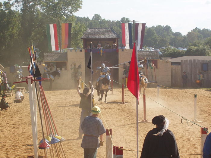 Hanging Horses Jousting Leisure Activity Lifestyles Low Angle View Occupation Pole Real People Renaissance Renaissance Festival Tournament