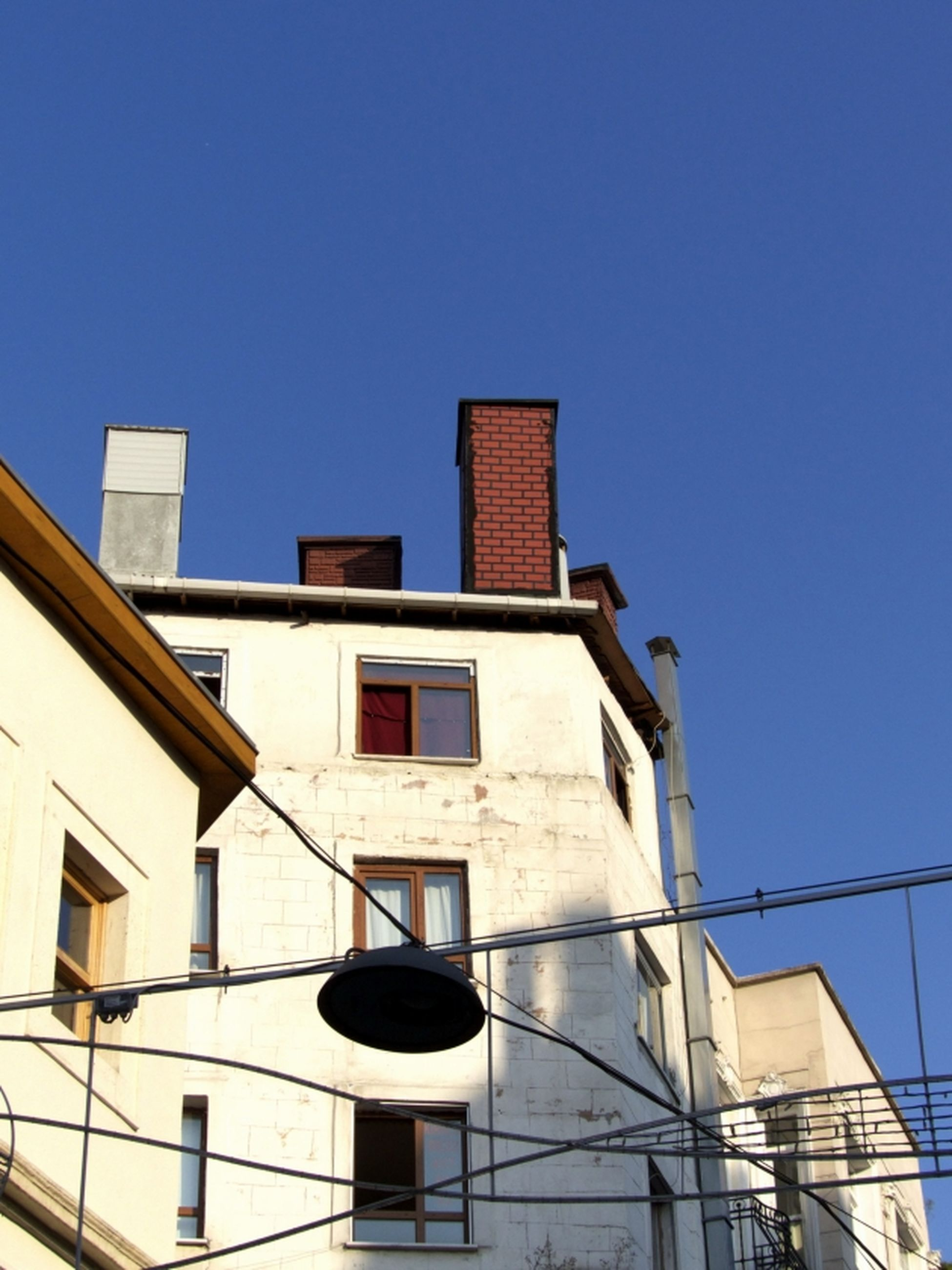 building exterior, architecture, built structure, low angle view, clear sky, no people, blue, day, outdoors, technology, sky