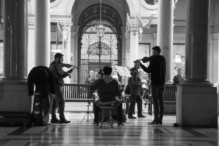 Indoors  Full Length Men Architectural Column People Adult Day Musician Music Classical Music Streetphotography Monochrome Public Places Monochrome Photography Streetartists Urban City Life City Scene Urban Lifestyle Black And White
