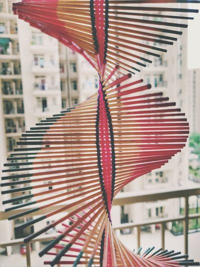 Close-up of multi colored umbrellas hanging on window