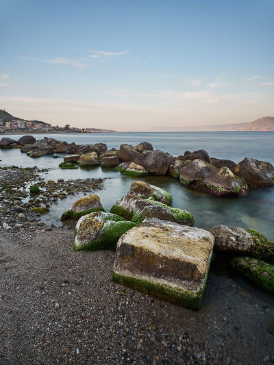 Beach of Messina Mediterranean  Sicily Beach Beauty In Nature Horizon Horizon Over Water Idyllic Italy Land Long Exposure Messina Nature No People Non-urban Scene Outdoors Rock Rock - Object Scenics - Nature Sea Sky Solid Sunset Tranquil Scene Tranquility Water