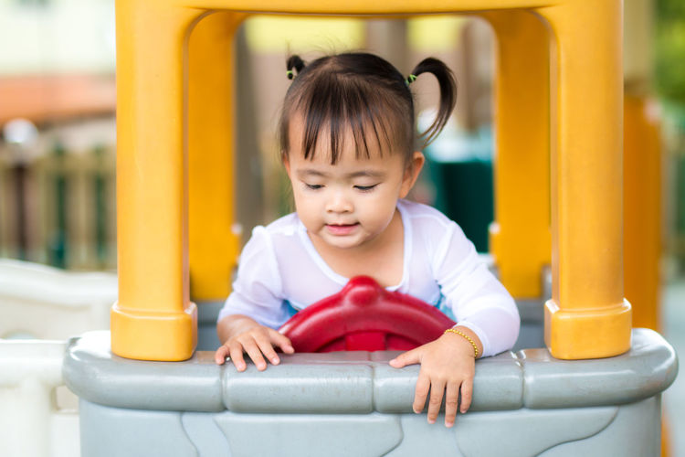 Babyhood Childhood Close-up Cute Day Front View Innocence One Person Outdoors People Playground Playing Real People Toy Car