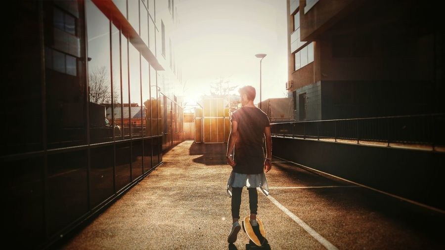 Urban Escape Urban Exploration OpenEdit Urban Lifestyle Popular Photos Lens Flare Sunset Sunny Day Skateboarding Skate Skatelife Longboarding Longboard Hipster EyeEm Bestsellers Young Adult Youth Spring Street Fashion Dressed Up Streetphotography Warm Orange Cruising Street Life