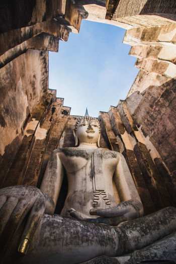 Low angle view of statue of temple