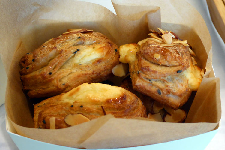 High Angle View Of Pastries In Paper Bag At Shop