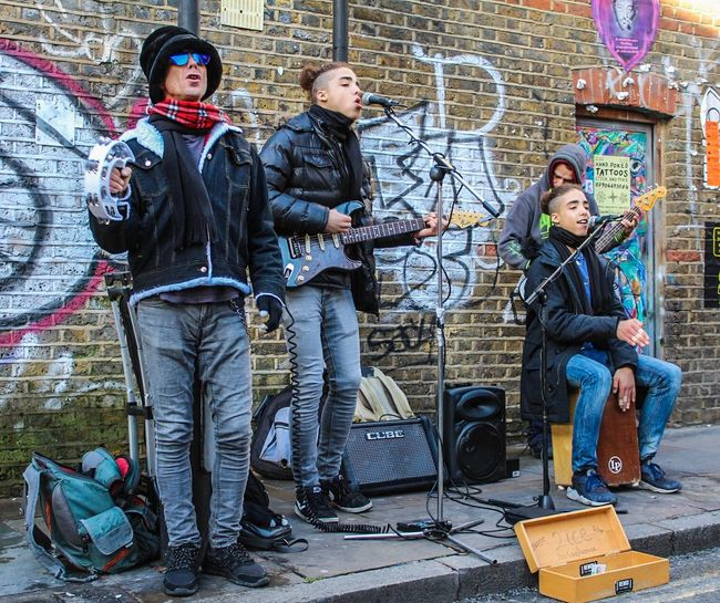 Full Length Music Musician Musical Instrument Performance Group Guitar Singer  Standing Guitarist Electric Guitar People Sound Recording Equipment Rock Group Rock Music Young Adult Recording Studio Adults Only Performing Arts Event Adult Day Band London Streets London Lifestyle Street Life Streetphotography