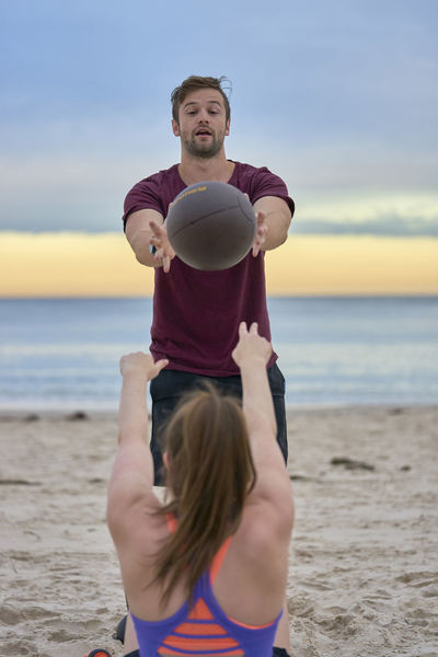 Athlete Balance Beach Boys Childhood Day Exercising Happiness Horizon Over Water Leisure Activity Lifestyles Men Nature Outdoors People Real People Sea Sky Smiling Sport Standing Strength Togetherness Training Water Workout Young Adult