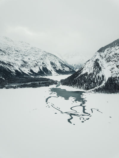Beautiful Plansee captured during in winter by drone. Winter Mountain Cold Temperature Snow Scenics - Nature Beauty In Nature Sky Mountain Range Tranquil Scene Nature Environment Day Non-urban Scene Tranquility Snowcapped Mountain No People Landscape Plant Land Formation Plansee Tirol  Austria My Best Photo