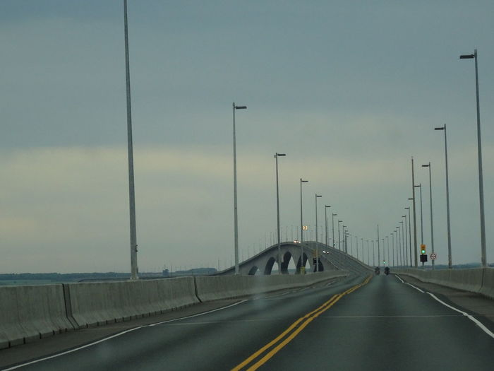 Driving on the Confederation Bridge, the 12,9 km bridge between New Brunswick and Prince Edward Island! Confederation Bridge Bridge - Man Made Structure Connection Diminishing Perspective Direction Dividing Line Highway Lighting Equipment Marking Motion Multiple Lane Highway Nature No People Outdoors Prince Edward Island Road Road Marking Sign Sky Street Street Light Symbol The Way Forward Transportation vanishing point