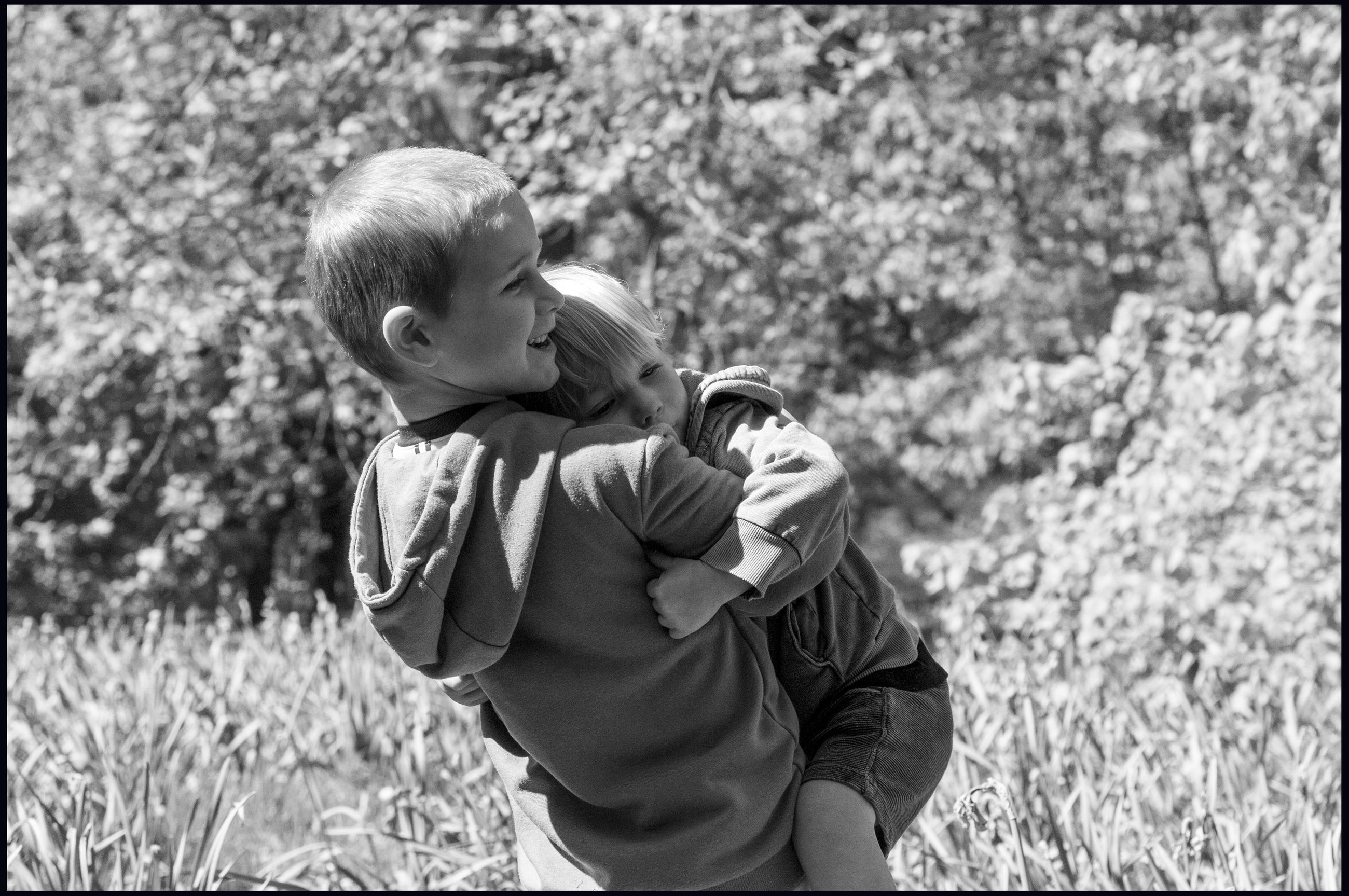 child, childhood, males, boys, men, real people, plant, family, day, leisure activity, nature, land, females, family with one child, casual clothing, field, bonding, innocence, positive emotion, son, outdoors