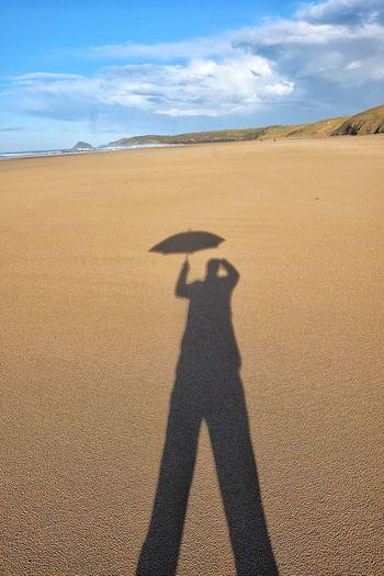 Shadow of man on sand dune in desert