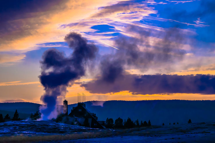 Sunset at Old Faithful, Yellowstone Sunset_collection Wyoming Yellowstone National Park Architecture Beauty In Nature Blue Cloud - Sky Day Horizon Over Water Nature No People Old Faithful Outdoors Power In Nature Scenics Sea Silhouette Sky Sunset Tranquil Scene Tranquility Tree Vapor Trail Water Wave