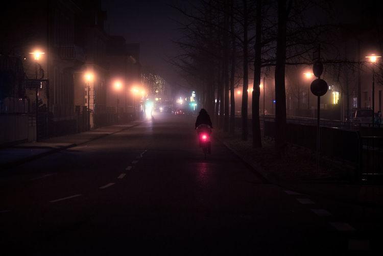 Into the lightsLights Bike City Fog Illuminated Night No People Outdoors Red Red Light Ride Road Street Street Light Transportation Tree Woman